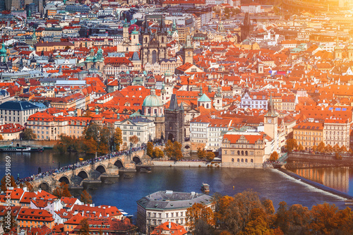 Staande foto Praag Autumn aerial view of houses and roofs of Prague old city town including Charles bridge. Czech Republic