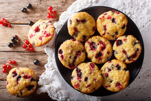 Freshly Baked Muffins With Black And Red Currant Berries Close-up. Horizontal Top View From Above