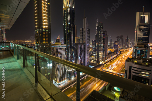 In de dag Stad gebouw Dubai skyline during night with amazing city center lights and heavy road traffic,UAE.