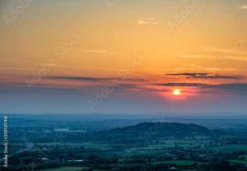Fotografie, Obraz  Sunset viewed from Crickley Hill looking towards Gloucester and the hills in the distance