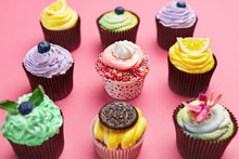 Colorful Cupcakes On Pink Back...