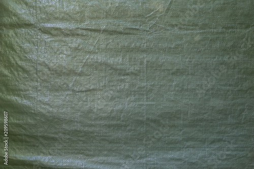 Full frame background of a wrinkled green tarp texture - 209598607