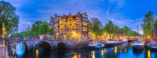 Valokuva  Amsterdam city skyline at night, Netherlands
