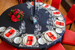 serving of the wedding table, beautiful festive decor in red