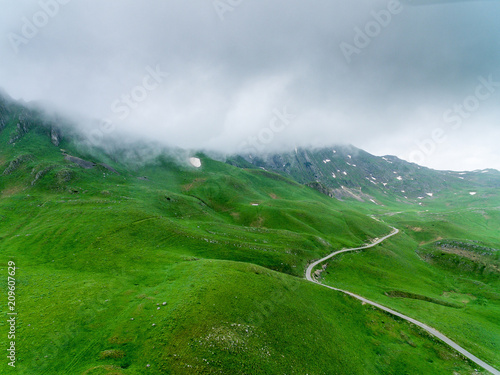 Keuken foto achterwand Groene Amazing aerial view at road in the mountain.Road through hills