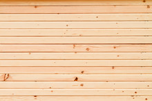 A Wall Of 2x4 Pine Studs Stacked On Top Of Each Other