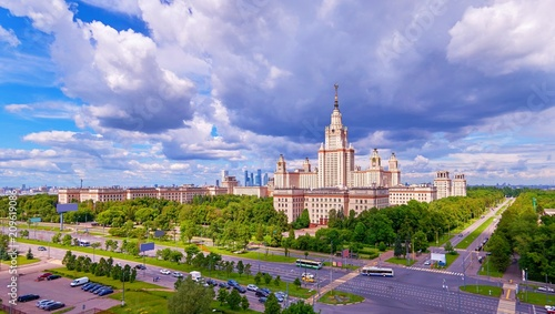 Tuinposter Purper Wide angle vibrant post card panoramic view of morning Moscow university campus under dramatic sky with light spots in spring