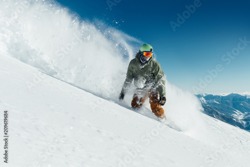 fototapeta na drzwi i meble male snowboarder curved and brakes spraying loose deep snow on freeride slope