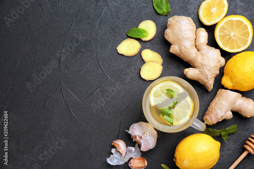 Cup with hot tea and other cold remedies on table, top view Wallpaper Mural
