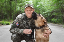 Man In Military Uniform With G...