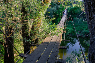 Pedestrian suspension bridge across the river