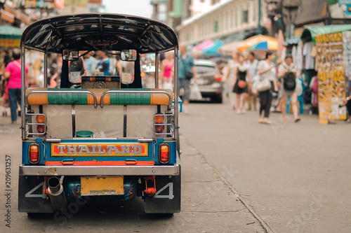 Photo Stands Bangkok Tuk Tuk (Thai traditional taxi car) parking for wait a tourist passenger at famous backpacker street in Bangkok (Khao San road), landmark and popular for tourist , sightseeing in Bangkok, Thailand