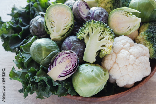 cruciferous vegetables, cauliflower,broccoli, Brussels sprouts, kale in wooden bowl, reducing estrogen dominance, ketogenic diet
