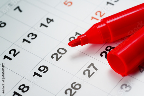 a red maker pen on the calendar