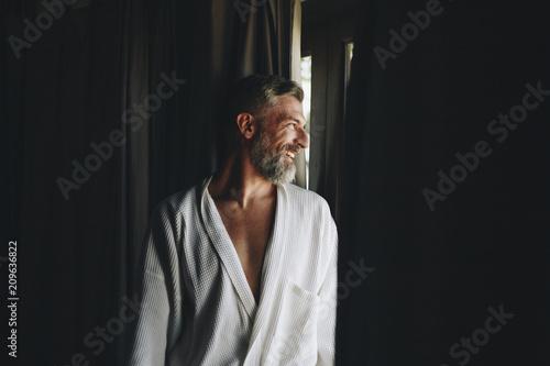 Fotografie, Obraz  Cheerful man in a bathrobe
