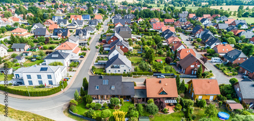 Obraz Typical German new housing development in the flat countryside of northern Germany between a forest and fields and meadows - fototapety do salonu
