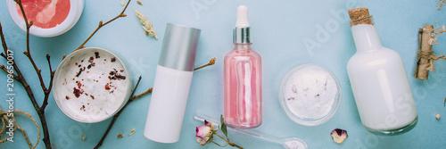 Fototapeta Organic bio cosmetics with herbal ingredients. Natural extract of rose, oils, serum. Copy Space, flat lay, Handmade obraz