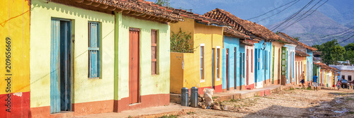 Panorama of colorful houses in a paved street of Trinidad, Cuba Wallpaper Mural
