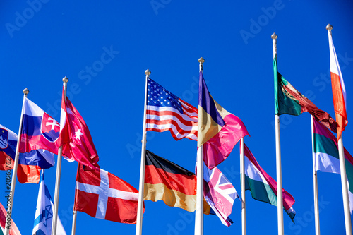 Fotografija  Flags of different countries flutters in the wind against