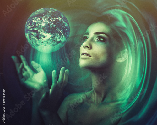 Blue Earth in her hands. Birth of a new universe. Fantastic female portrait
