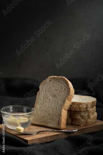 Deurstickers Brood bread slice whole wheat with dark tone