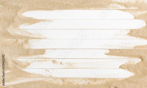 Obraz na płótnie Sand on a white planked wood