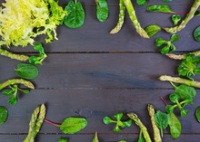 Fresh Asparagus And Green Herbs On Dark Background. Top View