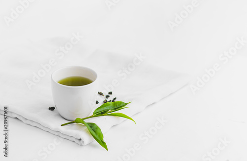 Green tea In white cup White background aroma