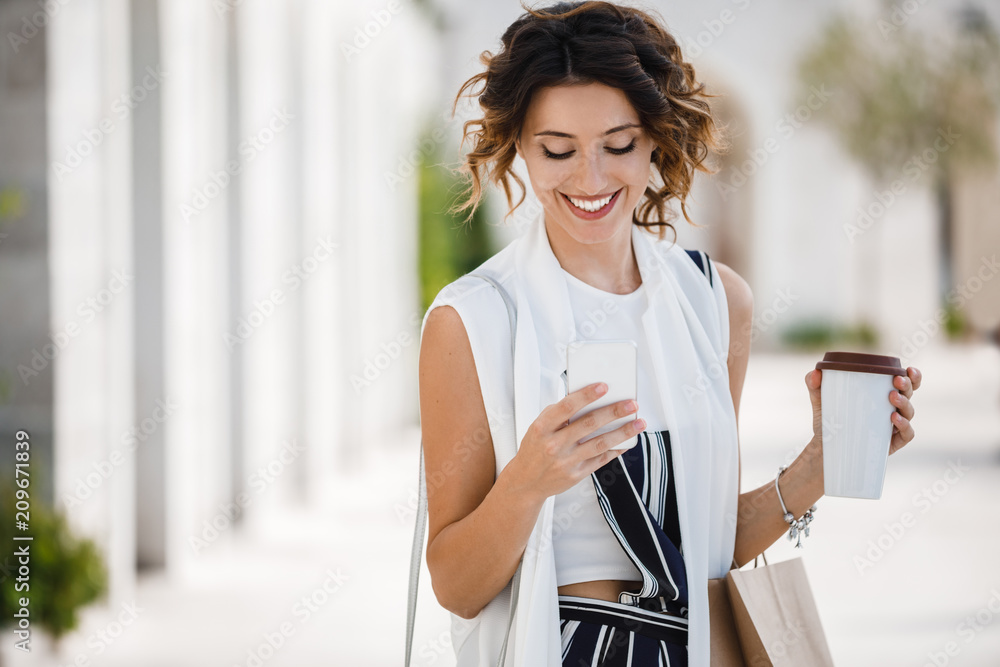 Fototapety, obrazy: A Woman Shopper Holding Cell Phone
