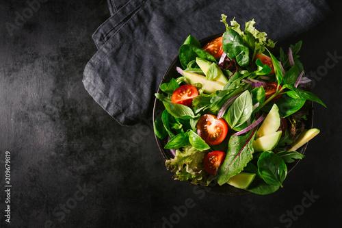 Detox tasty salad on dark table