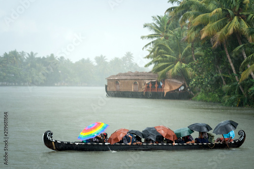 Poster Lieu connus d Asie Monsoon time. People crossing a river by boat in rain