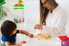 Child Psychology, Little Boy Stringing Beads