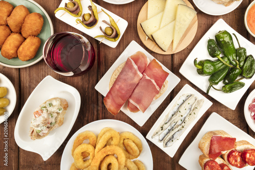 Spanish food. Overhead photo of various tapas with wine