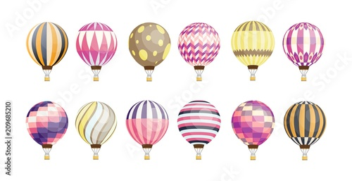 Fotografie, Obraz  Collection of round hot air balloons of various pattern and color isolated on white background