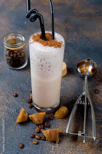 Foto op Plexiglas Milkshake Milk chocolate cocktail or cold whipped coffee with milk