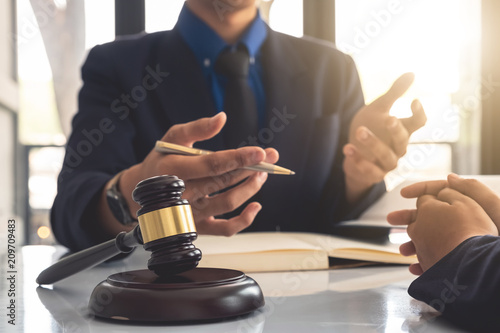 Business lawyer working about legal legislation in courtroom to help their custo Wallpaper Mural