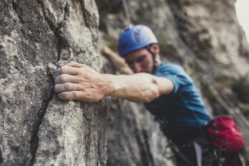 Spoed Fotobehang Alpinisme Mountaineer Climbing a Rock