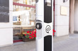 Electric vehicle charging (Ev) station with plug of power cable supply for Ev car. Electric Eco car charger in the city