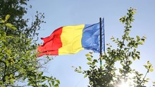 Romanian Flag Waving In The Wind