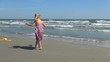 Child Playing with her Bucket on the Beach, Little Girl Running on the Seashore