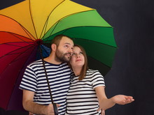 Pregnant Couple Posing With Colorful Umbrella