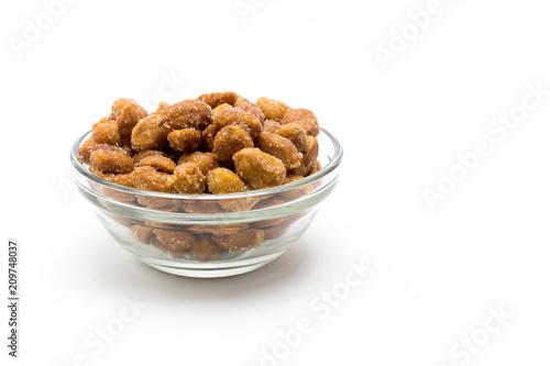 Foto op Plexiglas Voorgerecht Cacahuetes fritos con miel