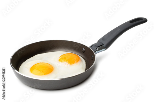 Deurstickers Gebakken Eieren Fried eggs on griddle