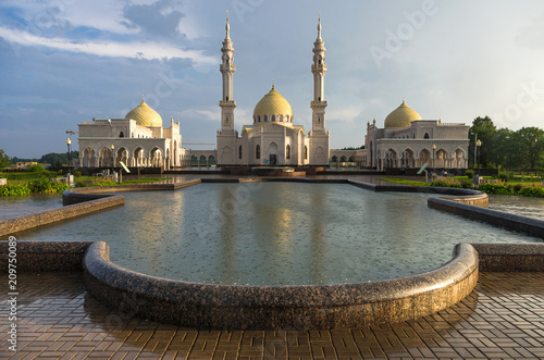 Foto op Plexiglas Indonesië White mosque in Bolgar city after rain with reflection in the water and beautiful sky, Tatarstan, Russia