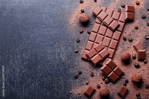 Fotografie, Obraz  Chocolate pieces with coffee beans and cocoa powder on wooden table