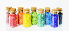 Multicolored Beads On A White Background