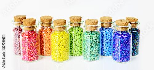 Obraz na plátně Multicolored beads on a white background