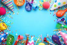Birthday Party Caps, Blowers And Candles On Blue Background