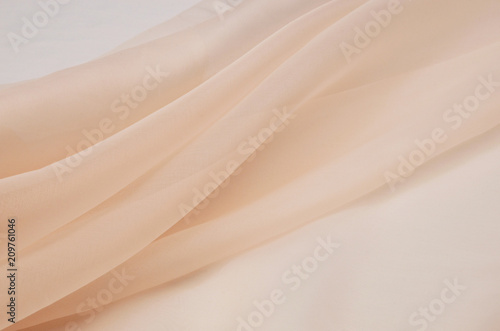 Foto op Canvas Stof Silk fabric, organza is light beige.