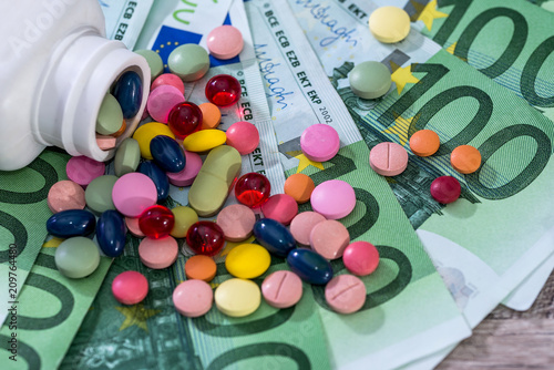Valokuva  Colourful tablets on hundred euro banknotes, closeup